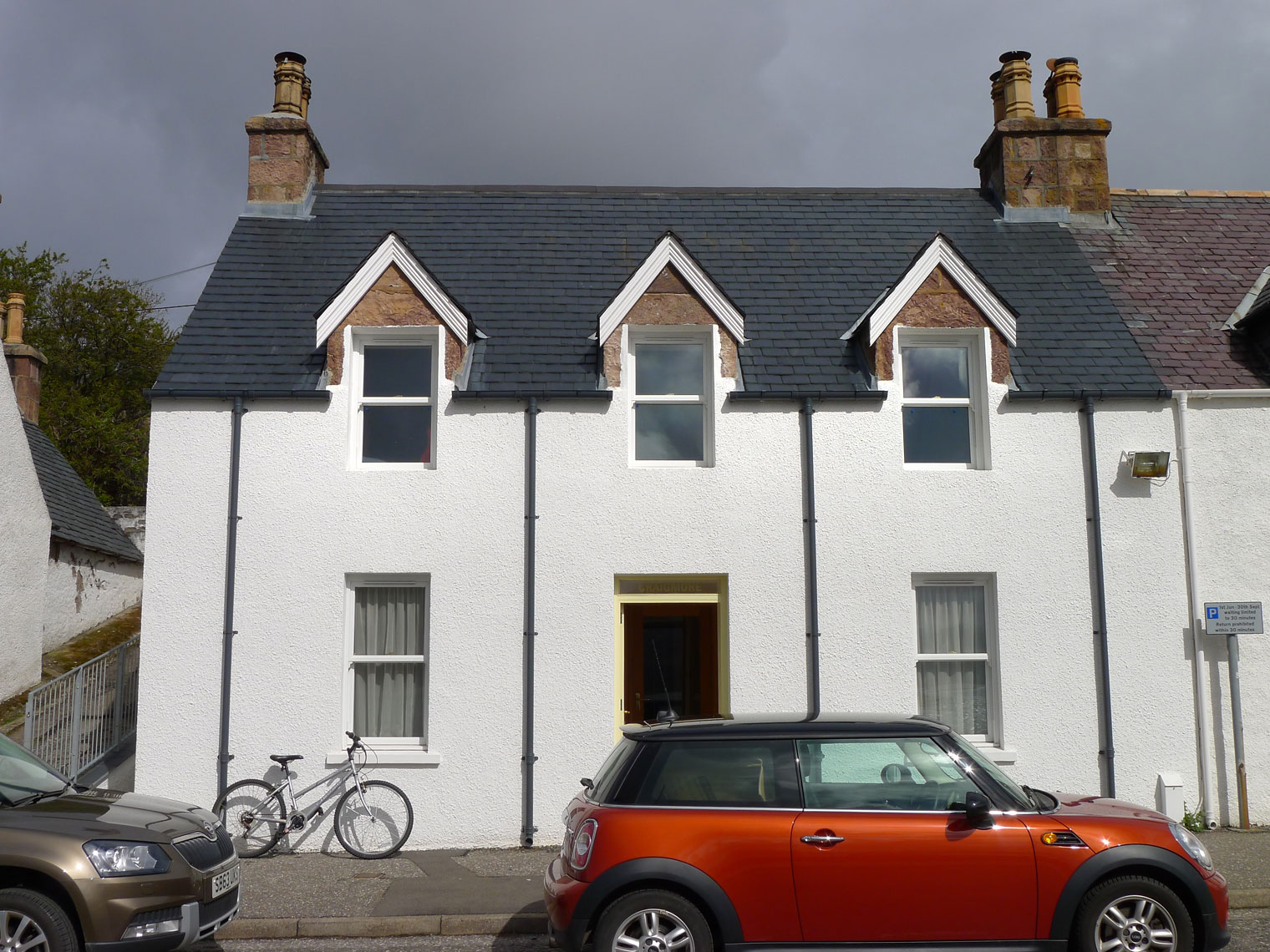 Traditional whitehouse cottage on Shore Street, overlooking Loch Broom